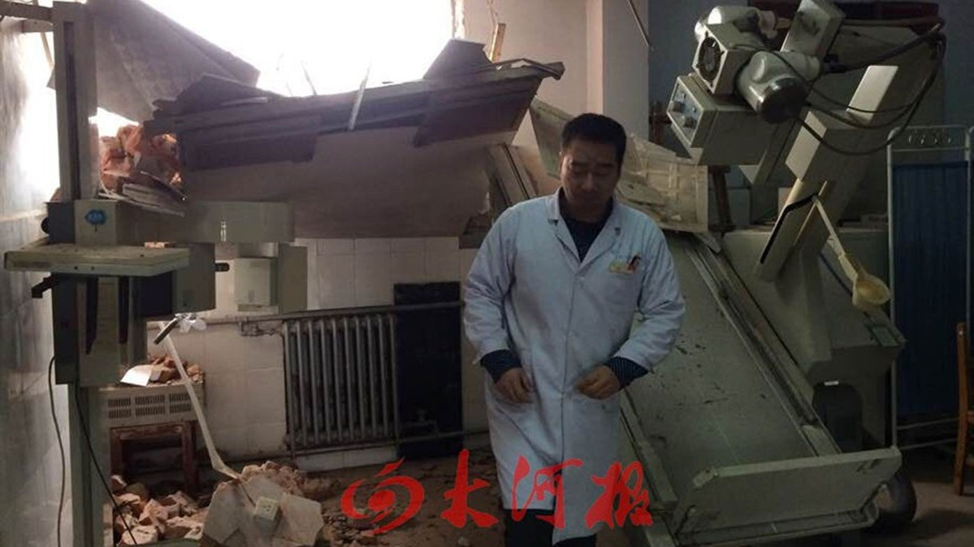 Doctors forced to flee as still in use Chinese hospital is partially demolished