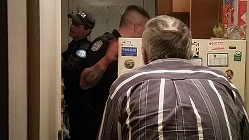The officers stocking the fridge. (Brian Gray, Facebook)