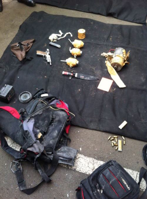 A suicide vest, explosives, pistols and a knife captured following the shootout with police. (Twitter)