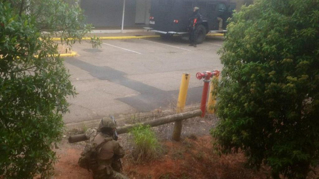 Stand-off with man barricaded in motel at Sunnybank, south of Brisbane, ends peacefully