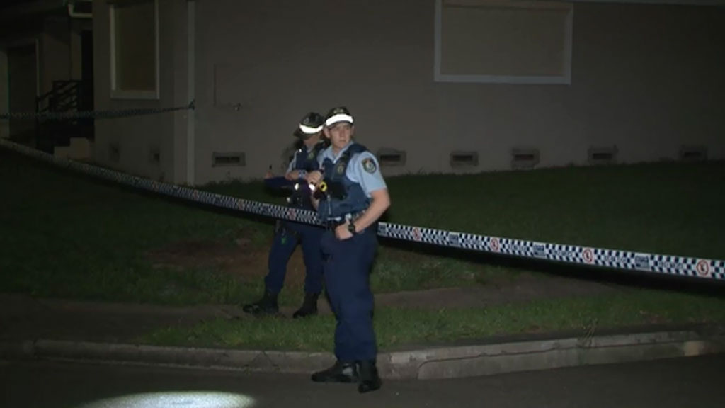 Four people escape injury after shots fired at a house in Sydney's south-west