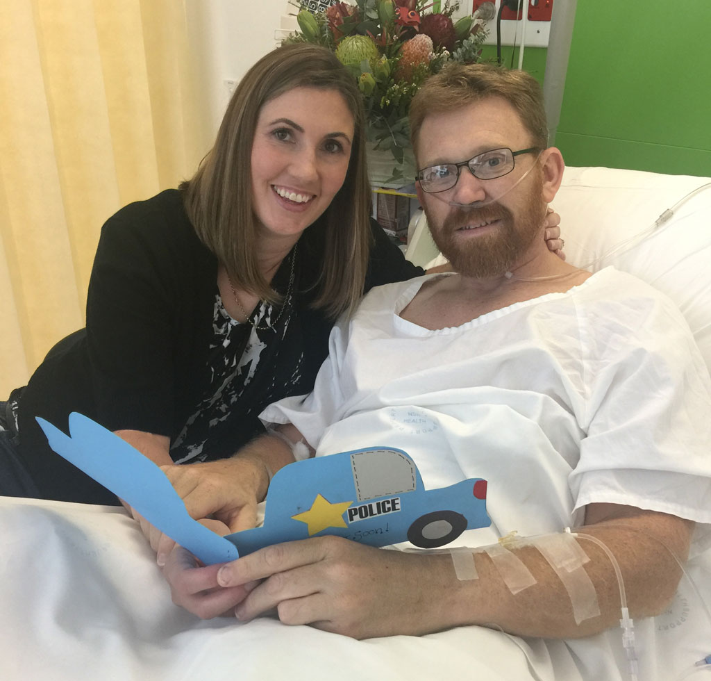 Senior Constable Luke Warburton with wife Sandra in hospital. (Supplied)