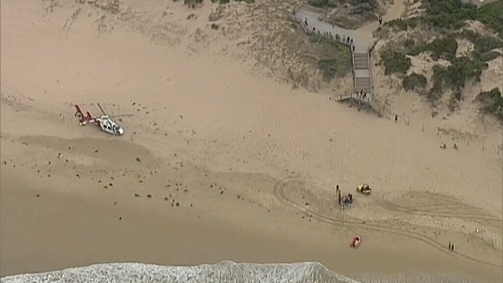 A medical helicopter was called to the beach. (9NEWS)