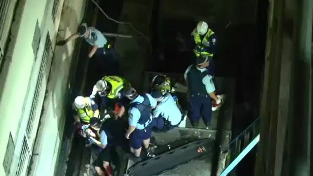 Man survives four-storey plunge from Sydney CBD balcony