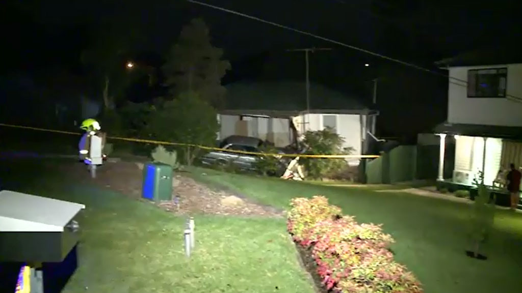 It is believed the car crashed into the house at high speed. (9NEWS)