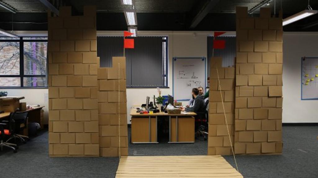 Office workers build huge cardboard castle around desks