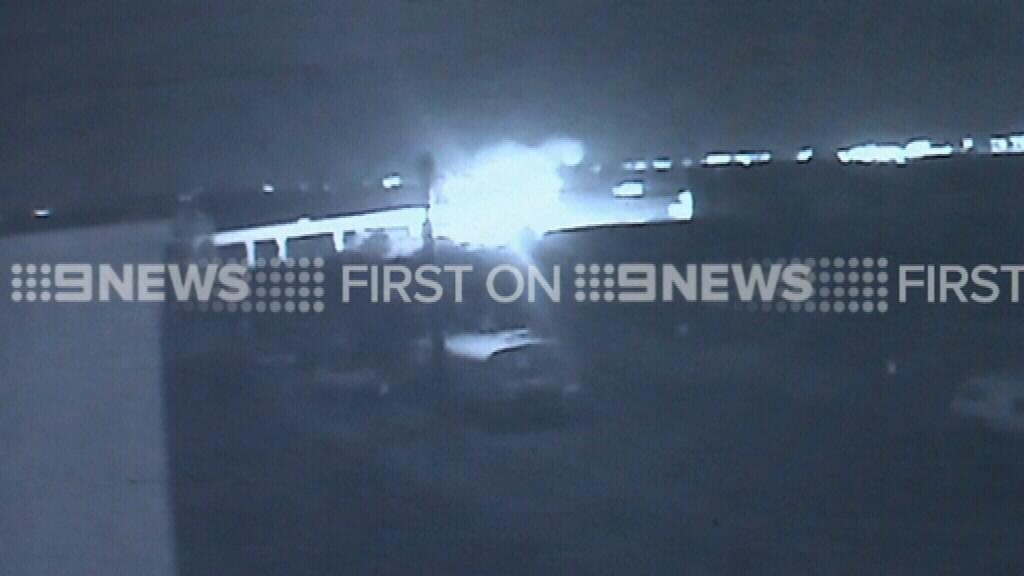 The car burst into flames after plunging from the bridge. (9NEWS)
