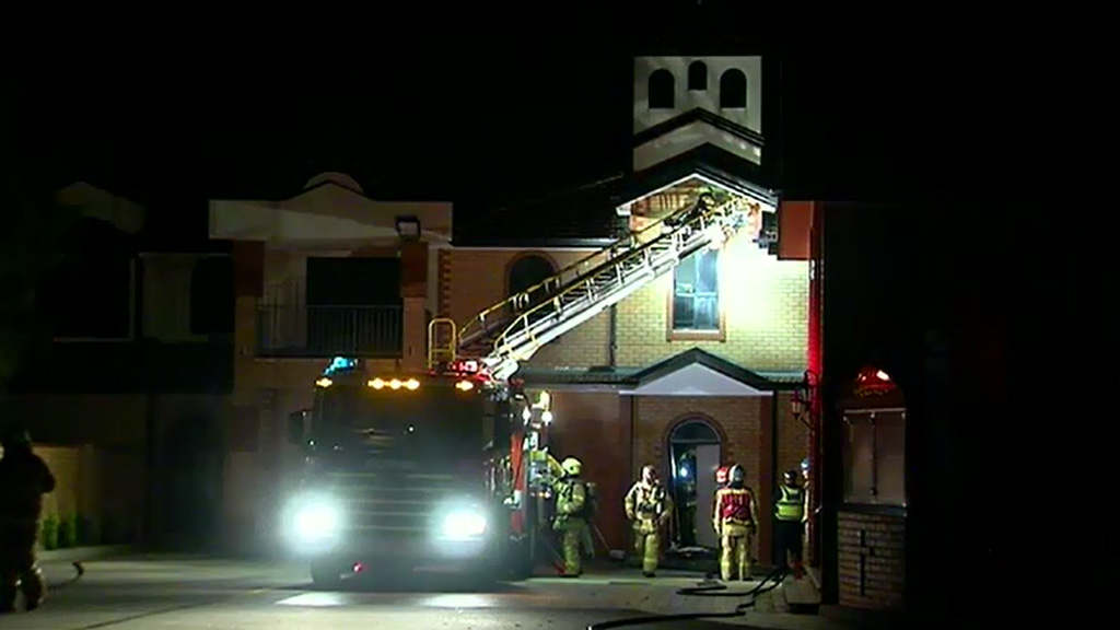 Leap of faith saves Melbourne priest from burning building