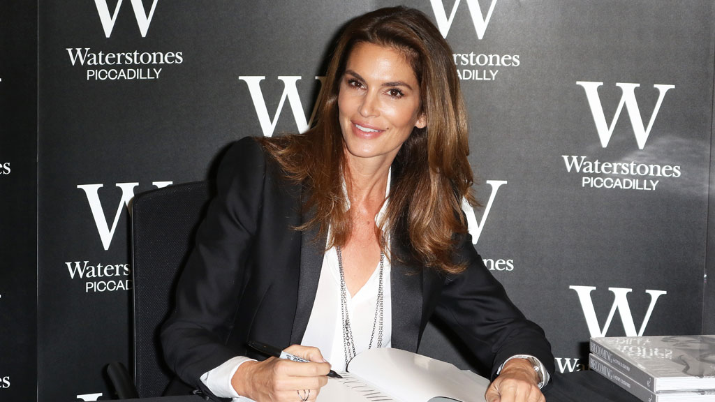 "Crawford signing her new book ""Becoming Cindy Crawford."" (AAP)"