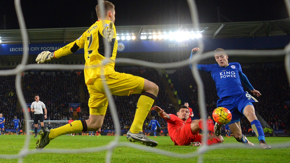 Vardy double keeps Leicester on top