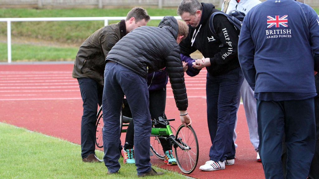 Prince Harry comes to the rescue when athlete is knocked from her wheelchair