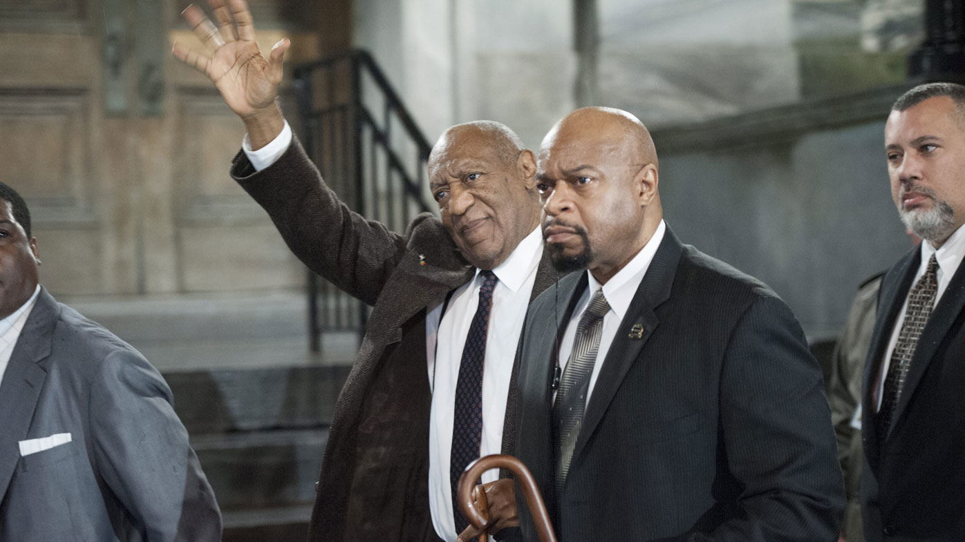 Bill Cosby waves to supporters. (AAP)