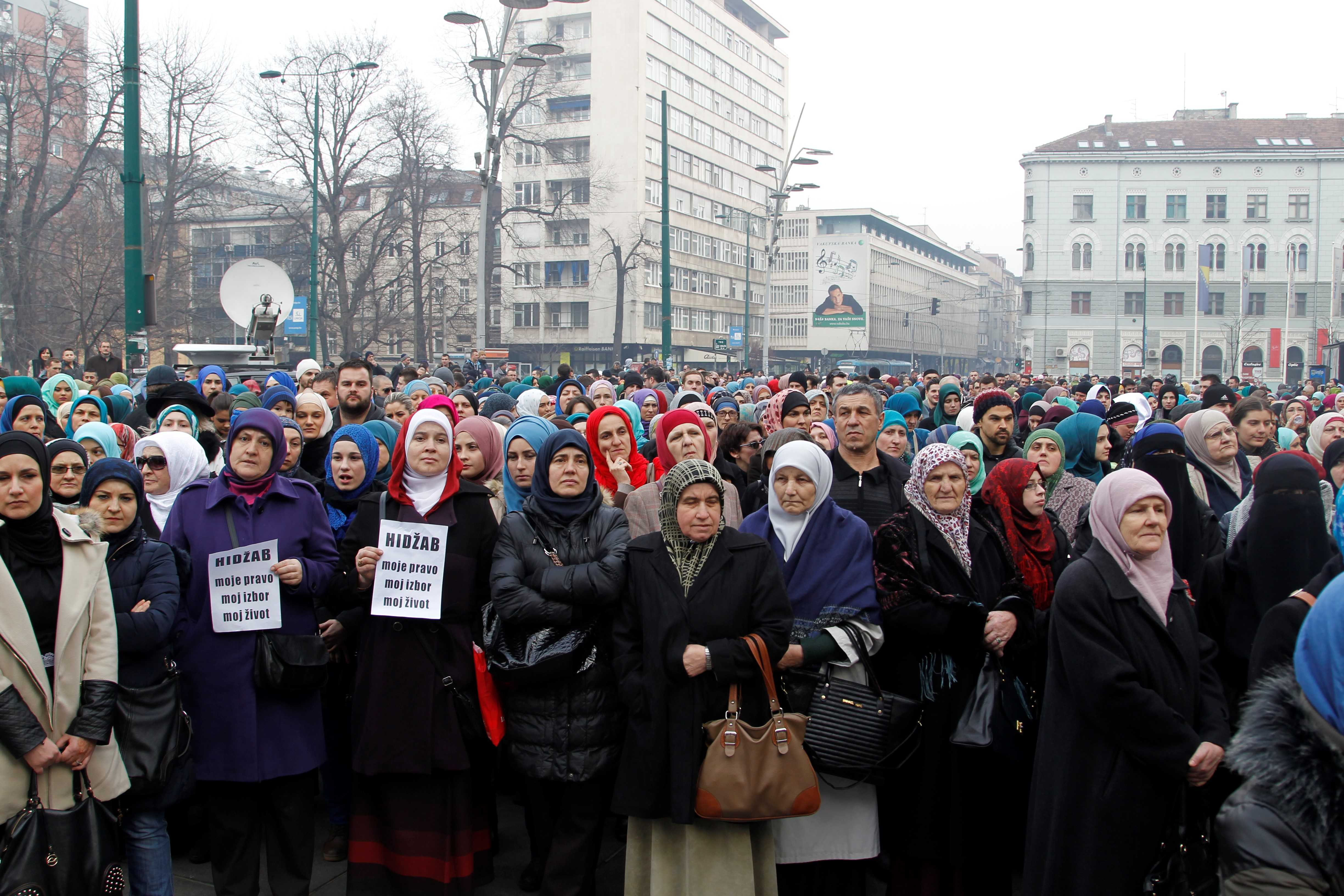 Marchers protest the decision to ban the display of religious symbols by employees of judicial institutions in Bosnia and Herzegovina. (AFP)