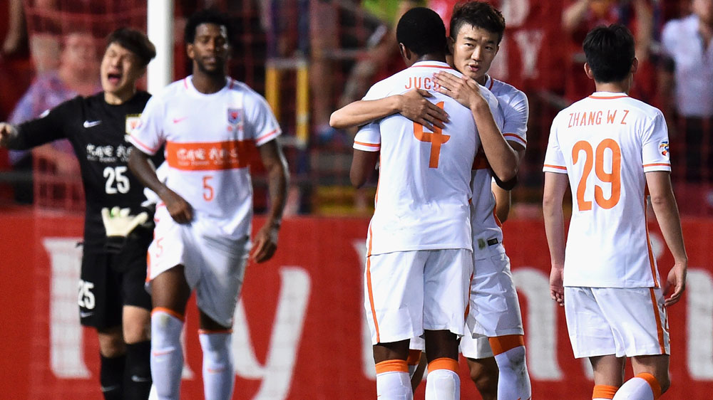 Shandong Luneng players celebrate their win. (Getty)