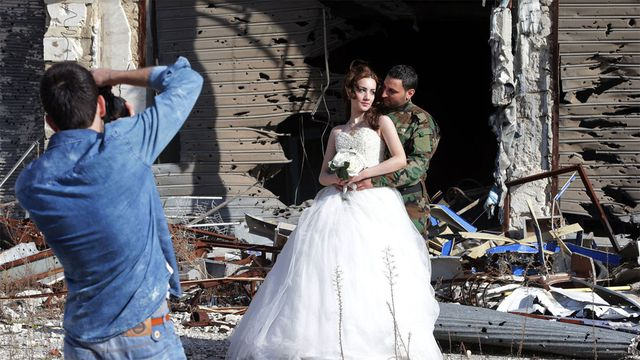 Syrian couple pose for wedding photos in ghostly, war-ravaged Homs