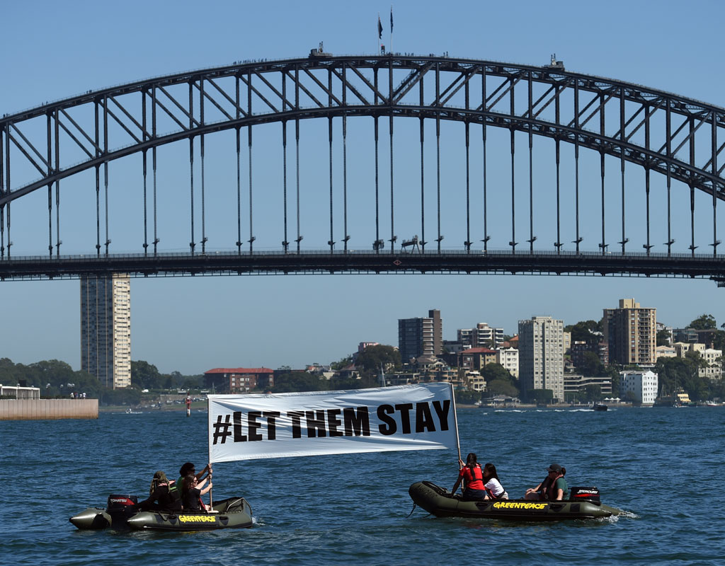 'Let Them Stay': Protesters take to Sydney Harbour to fight government's Nauru decision