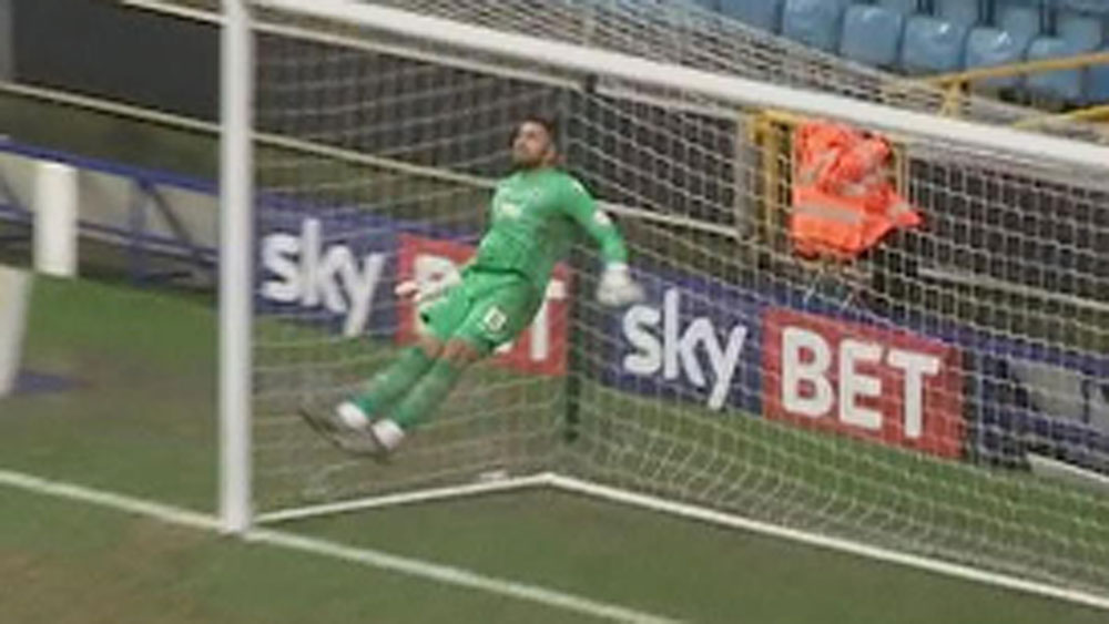 Goalkeeper uses his head to avoid own goal