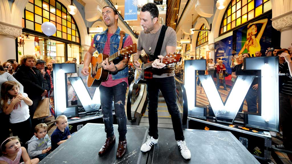 Guy Sebastian performs a Guerilla Gig for Channel V at the Queen Victoria Building in Sydney. (AAP)