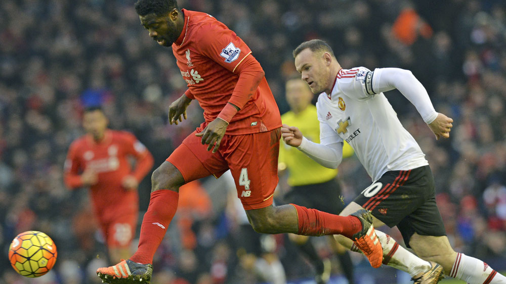 Liverpool defender Kolo Toure in action against Manchester United star Wayne Rooney. (AFP-file)