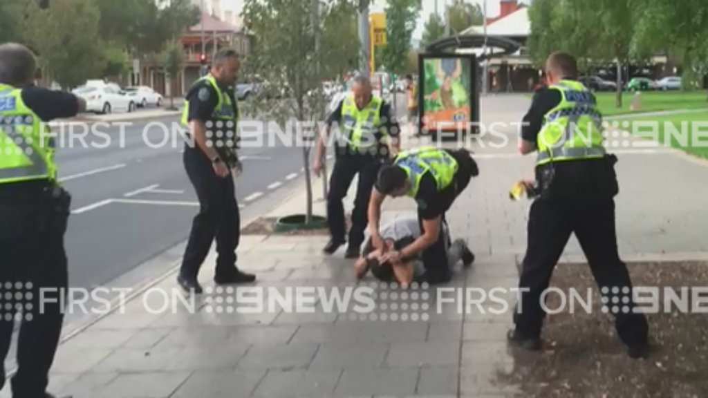 The man was arrested after threatening newsreader Will McDonald. (Will McDonald/9NEWS)