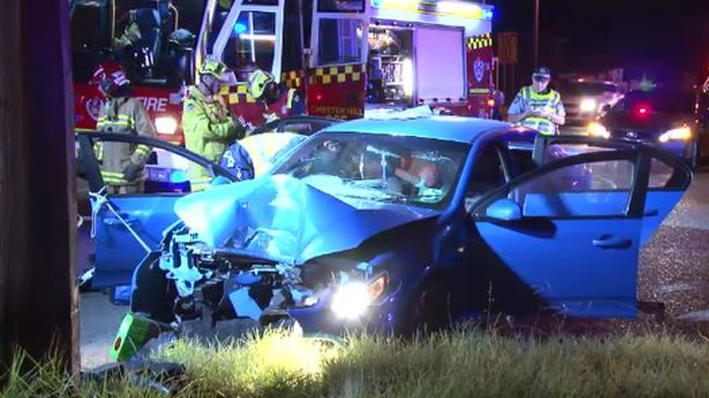 Man cut from car after crash in Sydney's west