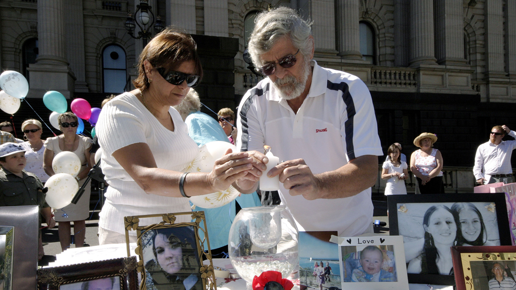 Mr Russouw's parents Lorna and Cecil at a victims of crime rally in Melbourne in 2009. (AAP)