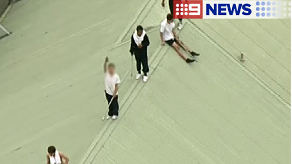 At least six inmates have climbed on top of one of the accommodation buildings at the Parkville youth justice centre. (9NEWS)