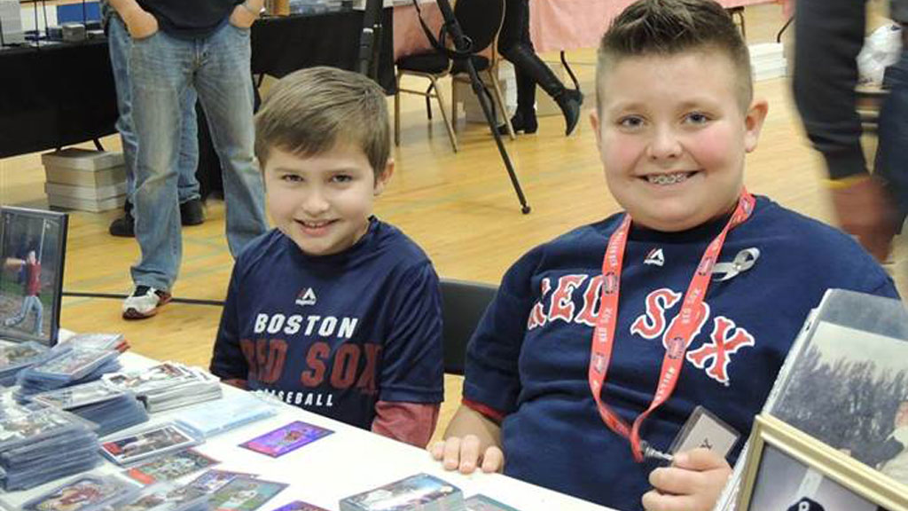 Boy sells off valuable baseball card collection to raise money for friend with cancer