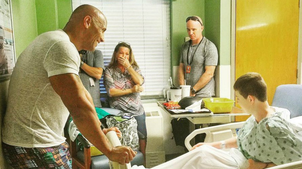 Actor Dwayne 'The Rock' Johnson takes break from filming to visit children in hospital