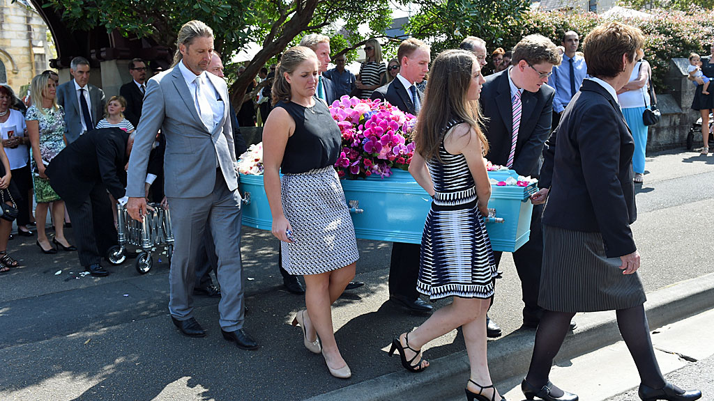 Mourners carry the casket of equestrian rider Olivia Inglis during her funeral service at St Jude's Church Randwick. (AAP)