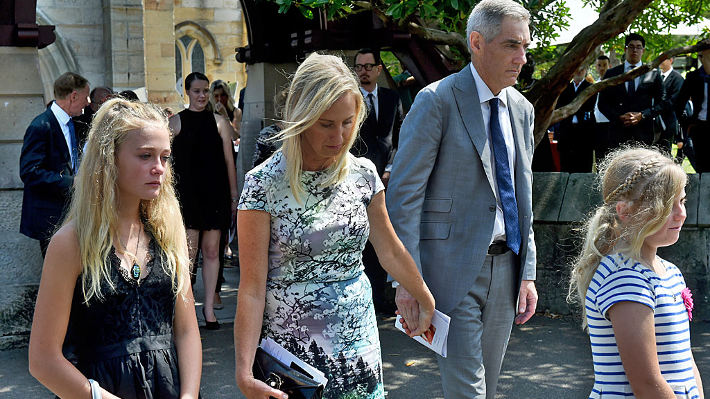 Charlotte and Arthur Inglis (centre) are seen during the funeral service for their daughter. (AAP)