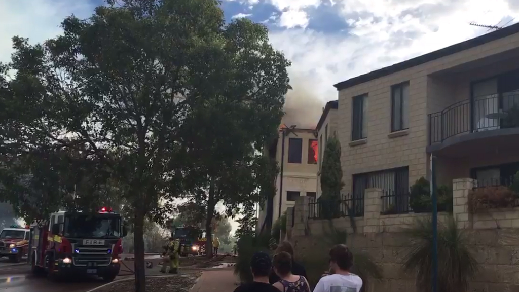 Bushfire damages home, forces evacuation of university north of Perth