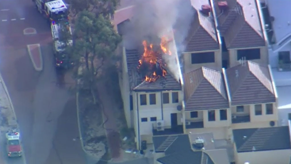 Man charged after bushfire tears through home and student accommodation in Joondalup in Perth's north