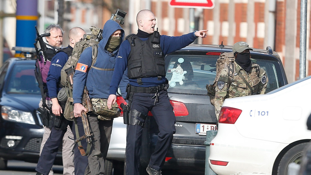 Two other men are still on the run as Belgian and French police shut down parts of Brussels. (AAP)