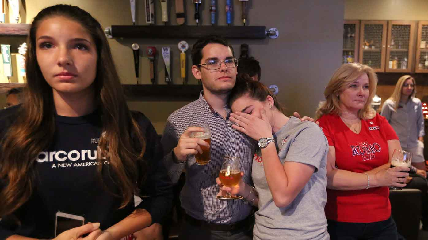 Tearful Marco Rubio supporters listen to his concession speech. (AAP)