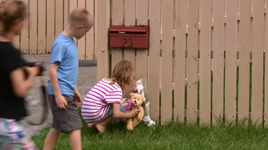 Children have laid flowers and a toy outside the home. (9NEWS)