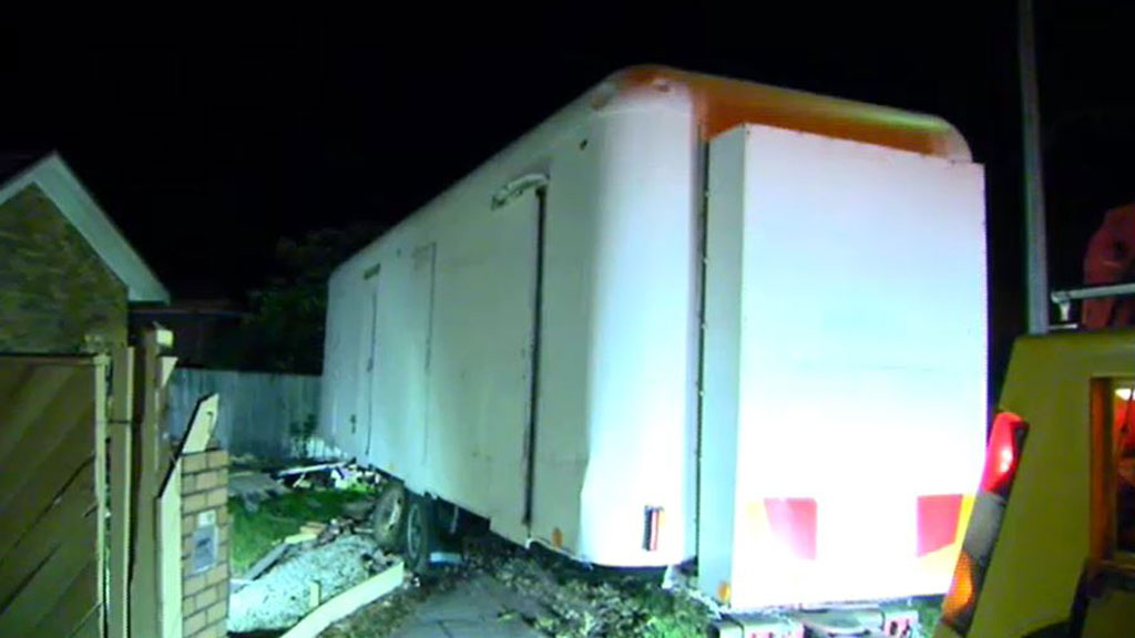 Police tracking owners of a caravan which almost crashed into a Melbourne home