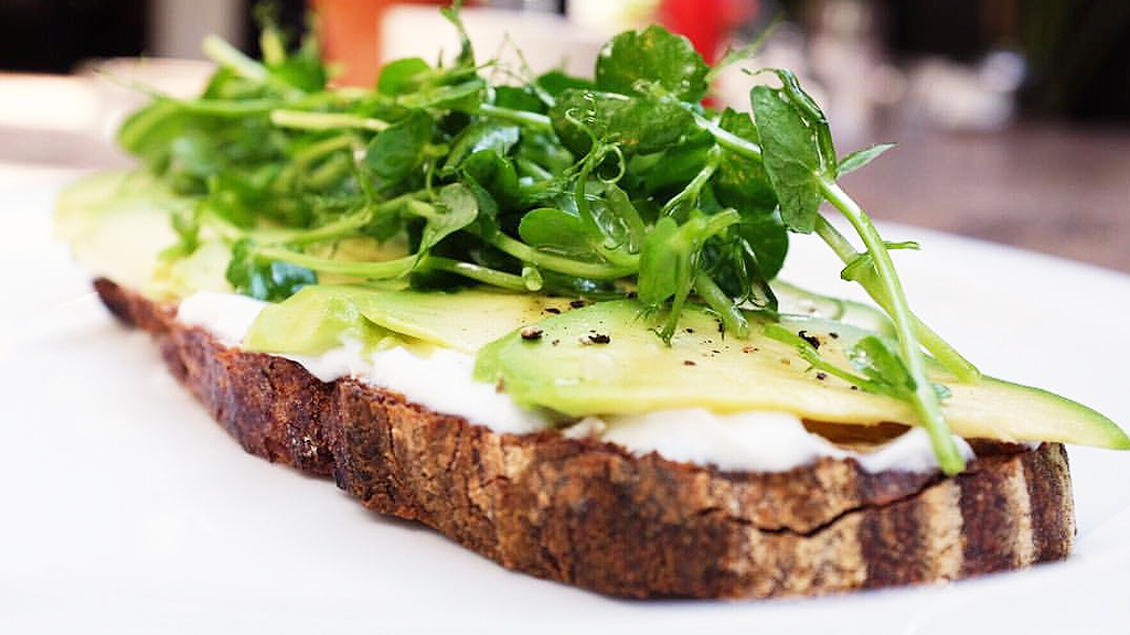 House-made labneh and avo on toast with pea shoots (Clarke's Bar & Dining)