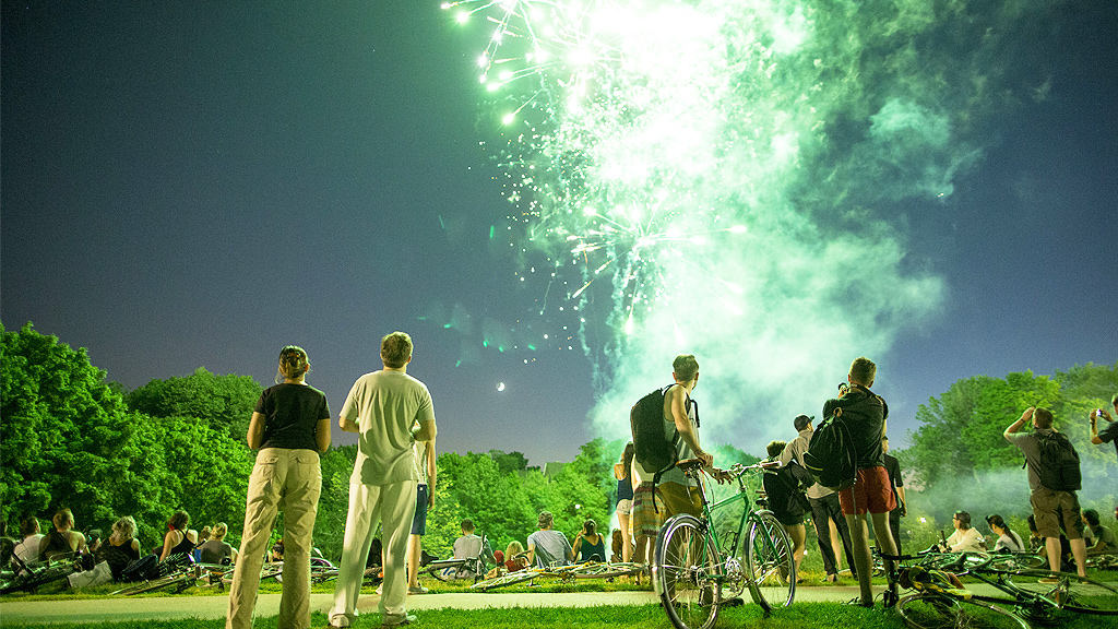 People lighting fireworks in Trinity Bellwoods Park on Canada Day (Getty)