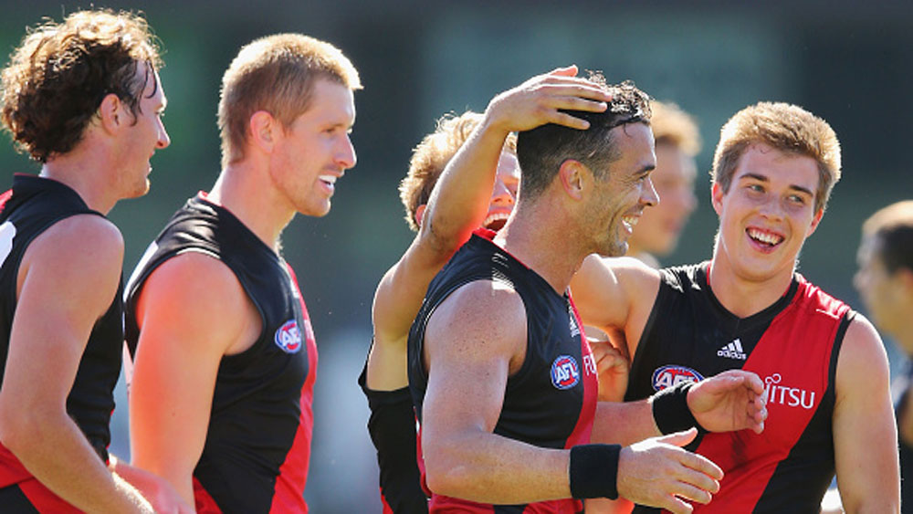 Ryan Crowley (second from right) with his new Bombers teammates. (Getty)