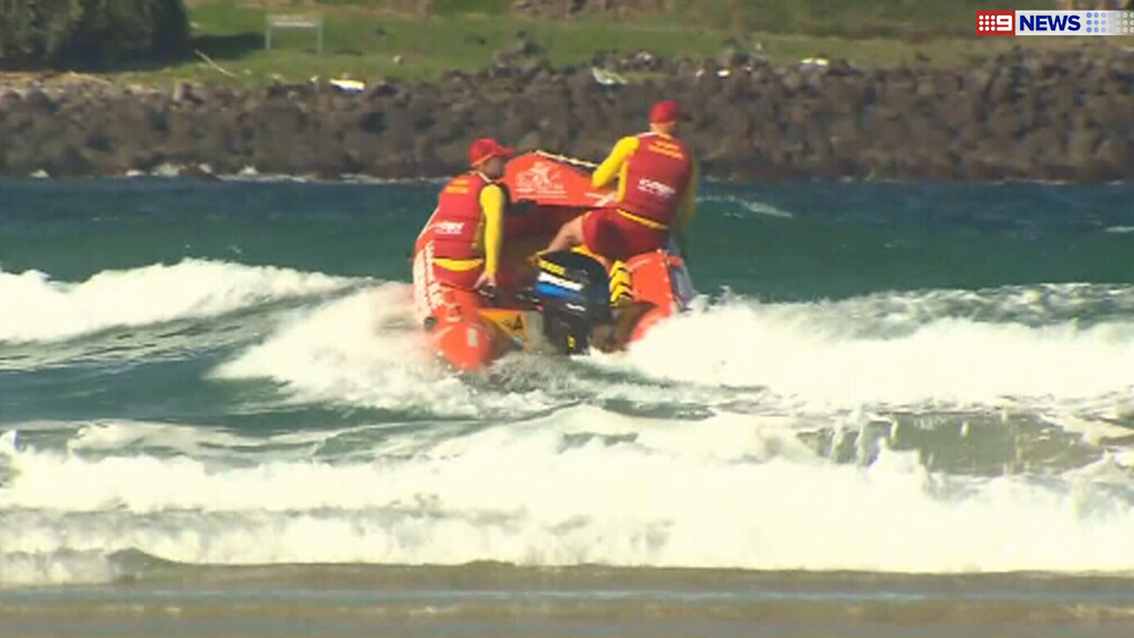 Lifesavers responded after a group was washed off rock at Fingal Head. (9NEWS)