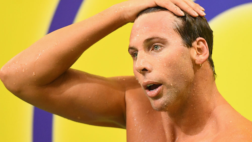 Swimmer Grant Hackett issues apology after plane drama
