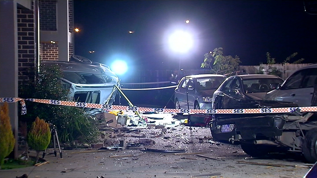Man expected to face charges after BMW slams into Melbourne unit block