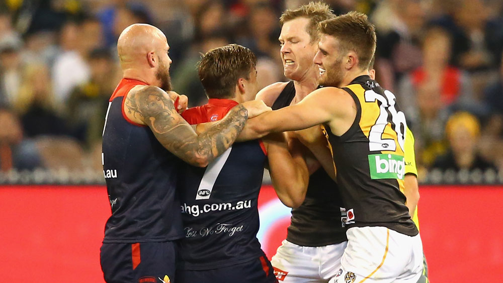 Jack Viney (c) scuffled with Jack Riewoldt. (Getty)