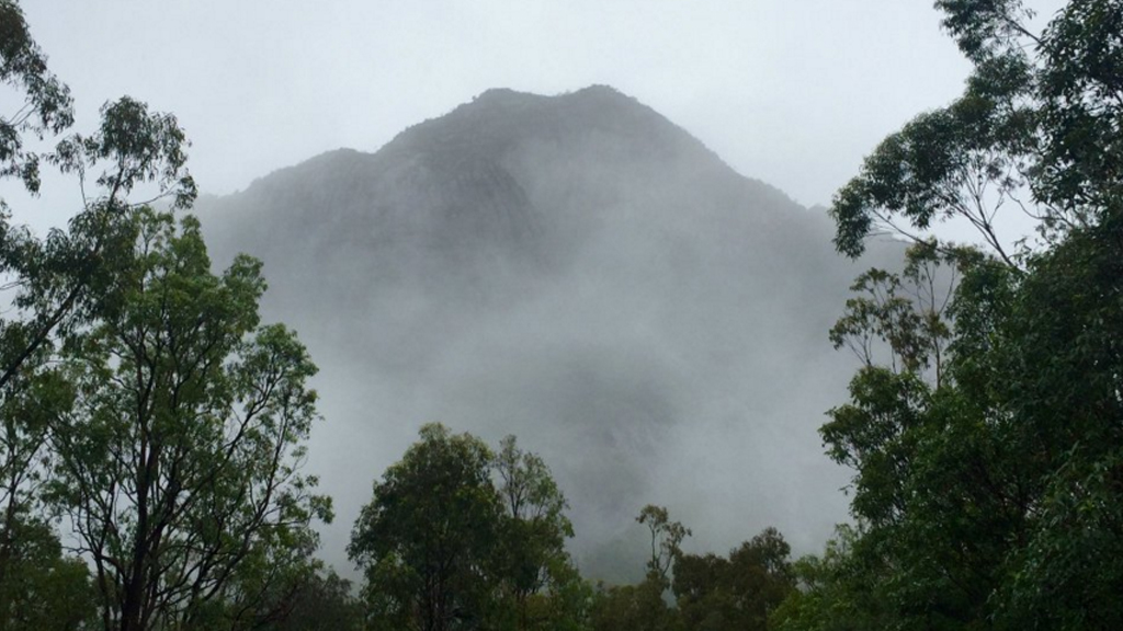 Rescuers have been unable to reach the hikers, who are stuck on Mount Beerwah. (9NEWS)