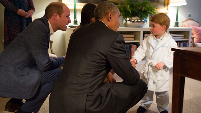 Barrack Obama and Prince George in his dressing gown. (AAP)