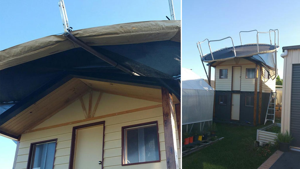 A family found their neighbour's trampoline had been blown onto the roof of their cubby house. (Image courtesy of Jasmin LeMarrec)