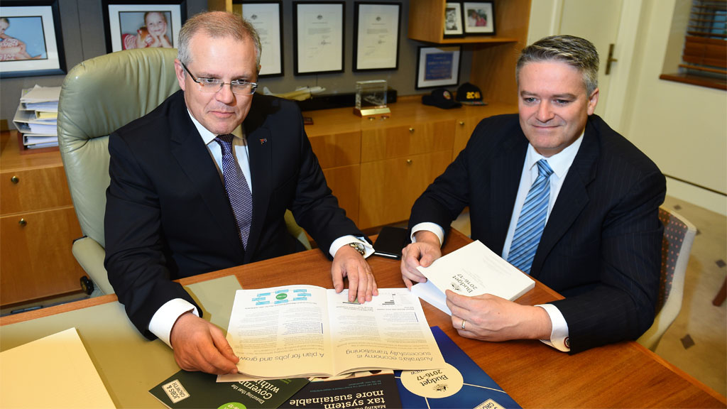 Treasurer Scott Morrison and Minister for Finance Senator Mathias Cormann look at the Budget Papers. (AAP)