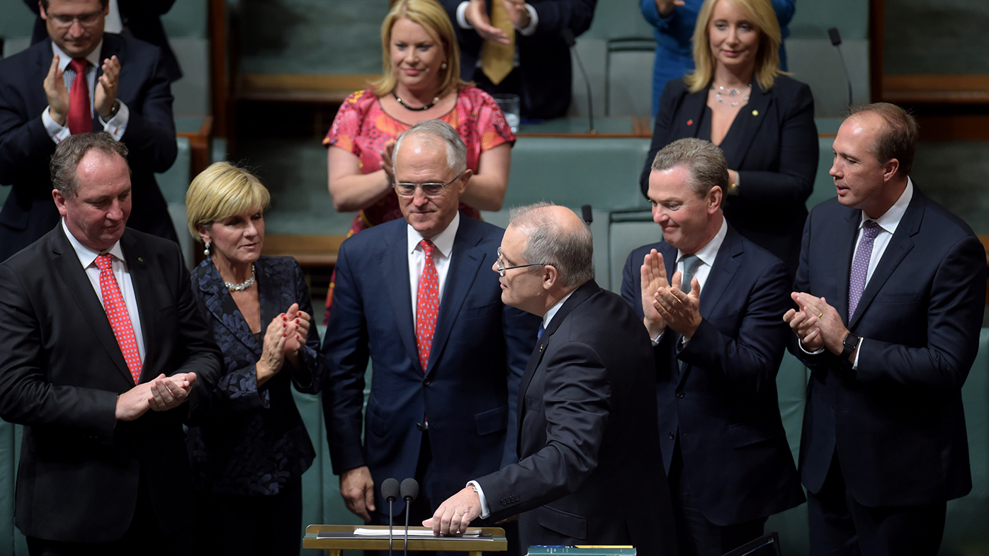Mr Scott Morrison is congratulated by the PM and his frontbench colleagues after delivering his first budget. (AAP)