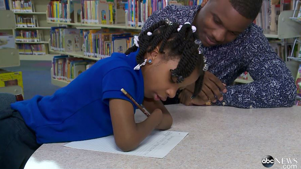 Young US girl born without hands wins national handwriting competition